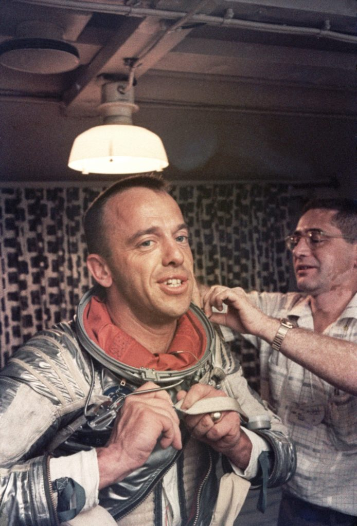 05 May 1961, 302 miles east of Cape Canaveral, aboard aircraft carrier, Atlantic Ocean --- Astronaut Alan Shepard and assistant try to take off his space suit, less than an hour after his flight in the in 1961, the first American manned flight in Space. --- Image by © Dean Conger/CORBIS