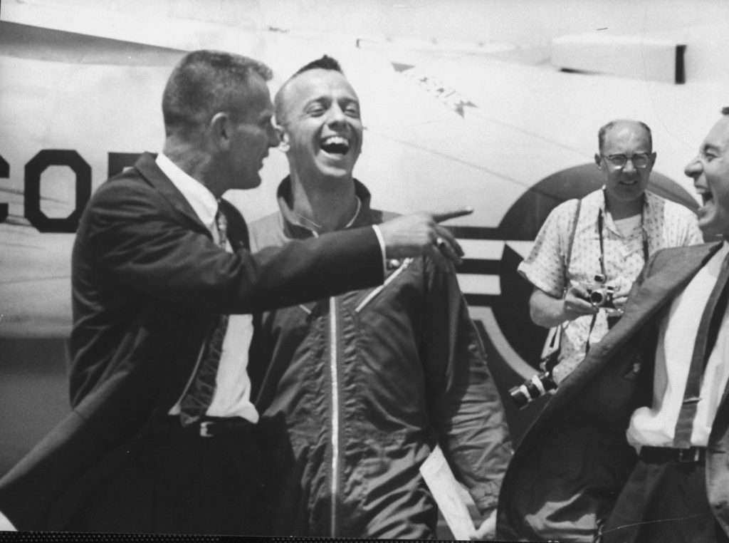 Commander Alan Shepard (C), with fellow astronauts at Grand Bahama Island after completing successful space flight. (Photo by Paul Schutzer//Time Life Pictures/Getty Images)
